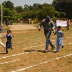 Dalit Sangh team running along with totally blind girl & boy in 100 mt. race on World Sight Day